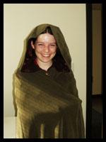B wearing my cloak